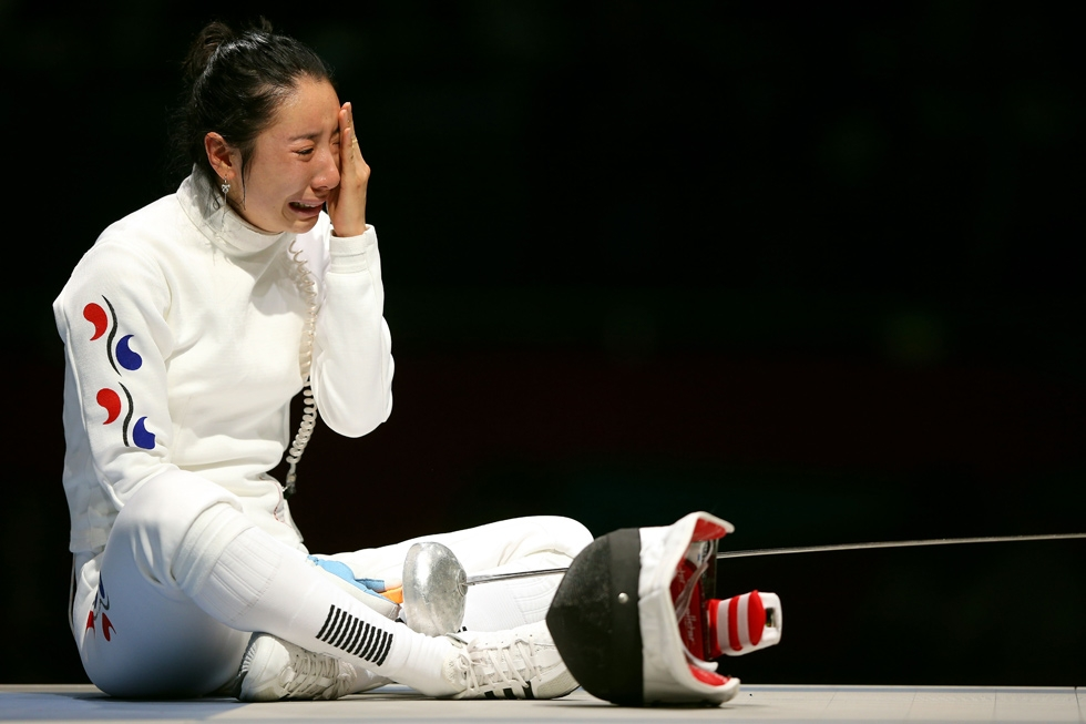 South Korean épée fencer Shin A-Lam after losing due to a clock stoppage issue during the Women's Epee Individual Fencing Semifinals at the Olympics in London on July 30, 2012. (Hannah Johnston/Getty Images)