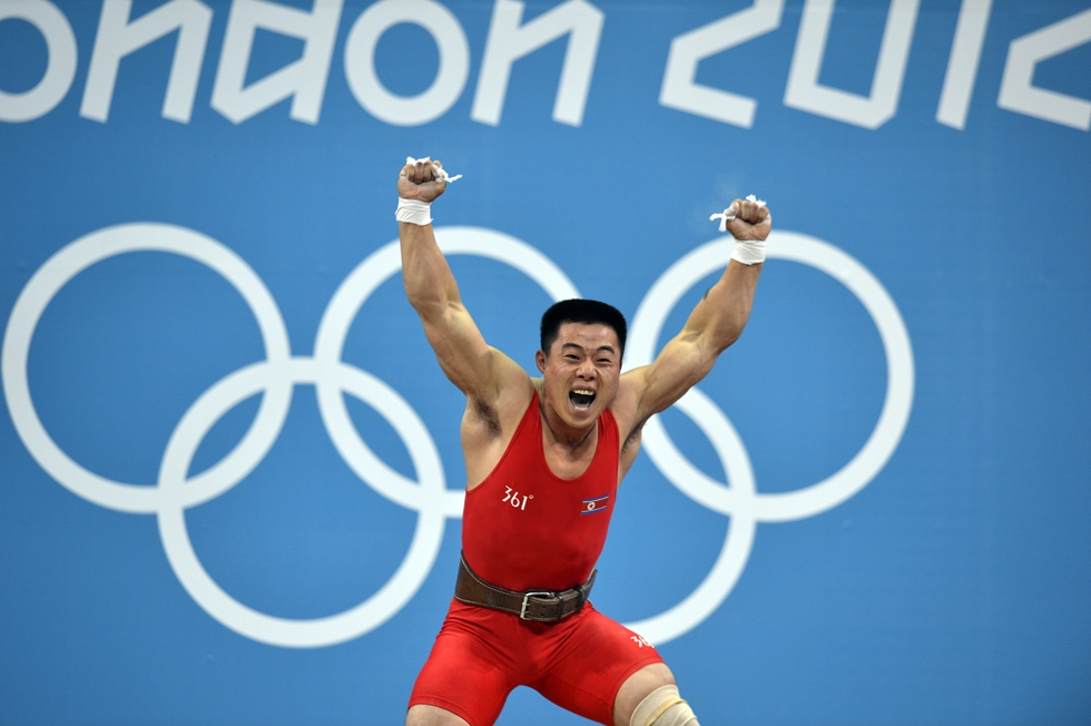 North Korean weightlifter Kim Un Guk celebrating the thrill of victory after winning the gold medal at the Olympics in the Men's 62-kilogram division, setting a world record total of 327 kg in London on July 30, 2012. (Yuri Cortez/AFP/GettyImages)