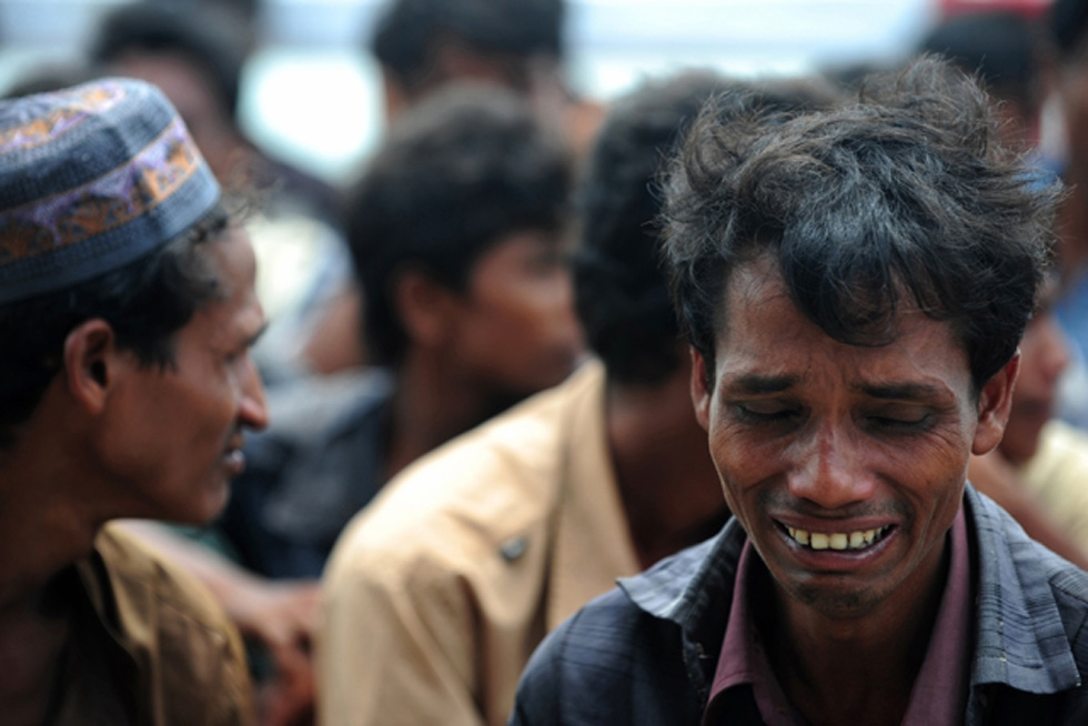 Sectarian violence and revenge attacks broke out between Buddhists and Muslims in Myanmar's Rakhine state in June. These refugees were trying to enter Teknaf, Bangladesh on June 18, 2012. (Munir uz Zaman/AFP/Getty Images)
