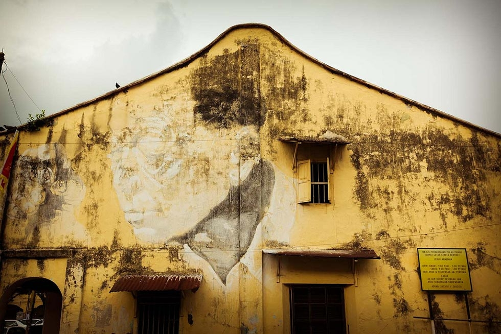"""Man on Armenian Street,"" at the corner of Canon Street and Armenian Street, depicts Zacharevic's neighbor, Mr. Ng Chai Tiam. (Catherine Mar)"