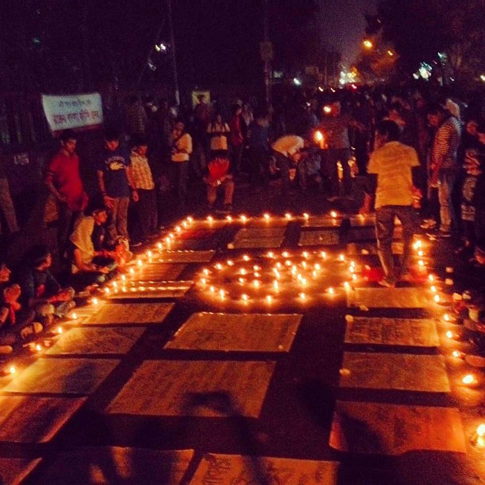 Protestors organize a series of posters and candles as they wait in Shahbag. (Naorose Bin Ali)