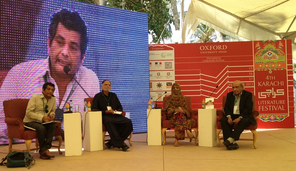 Mohammed Hanif (far left and onscreen), best known for his 2008 novel A Case of Exploding Mangoes, at the 2013 Karachi Literature Festival. (Annie Ali Khan)