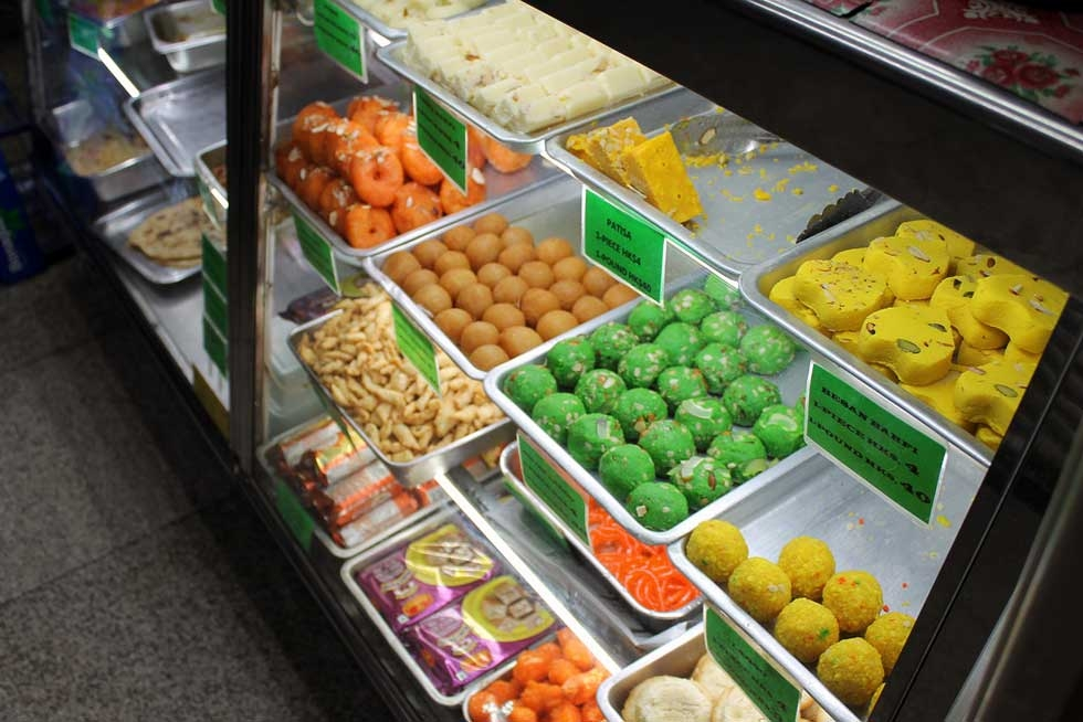 Indian desserts go global, from in a stall in Hong Kong. (ironypoisoning/Flickr)