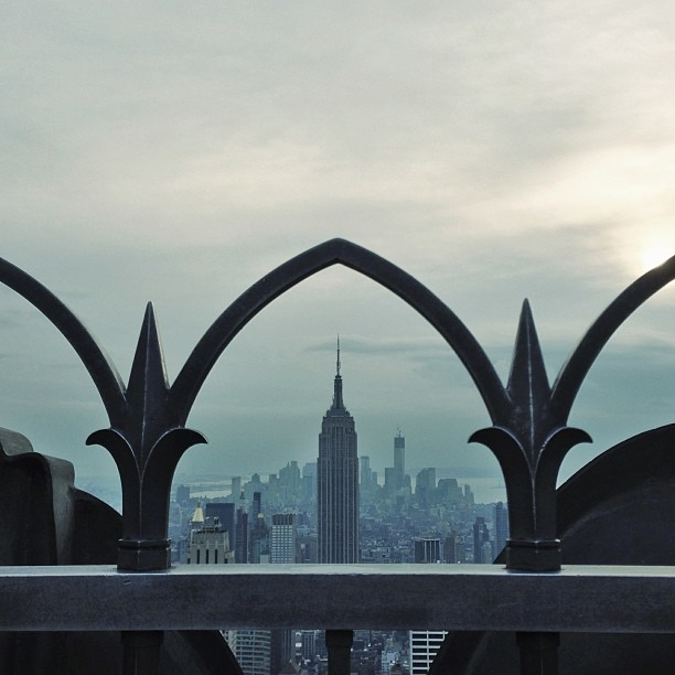 """The Empire State Building as seen from the Top of the Rock in Manhattan. When I look at this image, I can remember having to hold my breath to get all the lines perfect. And I miss New York."" (Pei Ketron)"