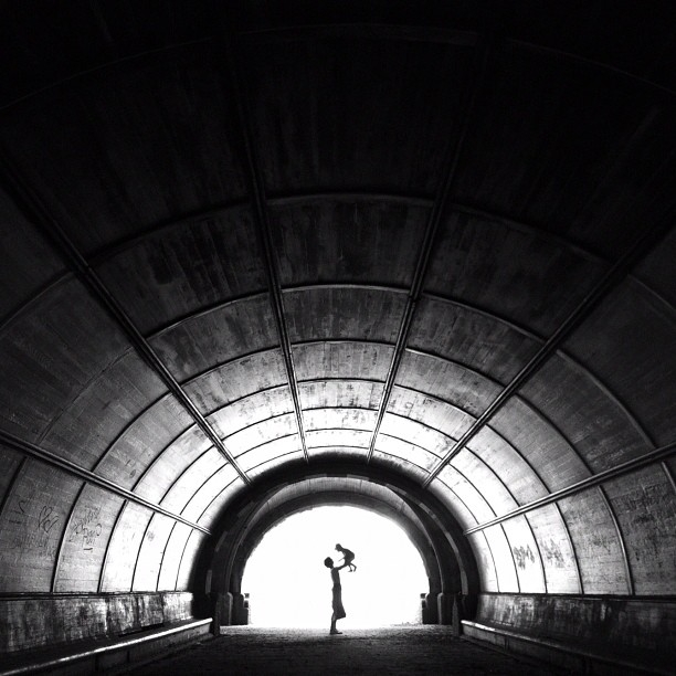 """I am in love with this photo of a friend of mine with her daughter that was taken in my favorite tunnel in Prospect Park, Brooklyn. In addition to the tender moment, it combines many photographic elements I am drawn to: leading lines, silhouettes, and glowing light."" (Pei Ketron)"