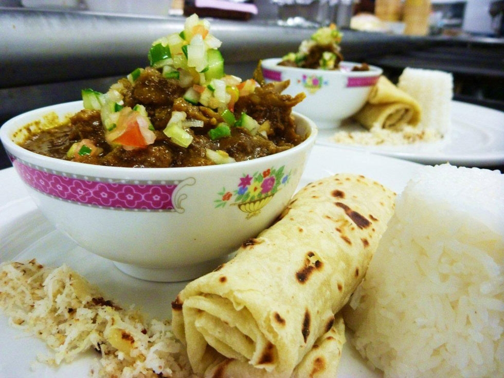 Wild duck curry, coconut chutney, tamarind relish, coriander salsa, roti cigar and steamed rice. (lanceseeto.com)