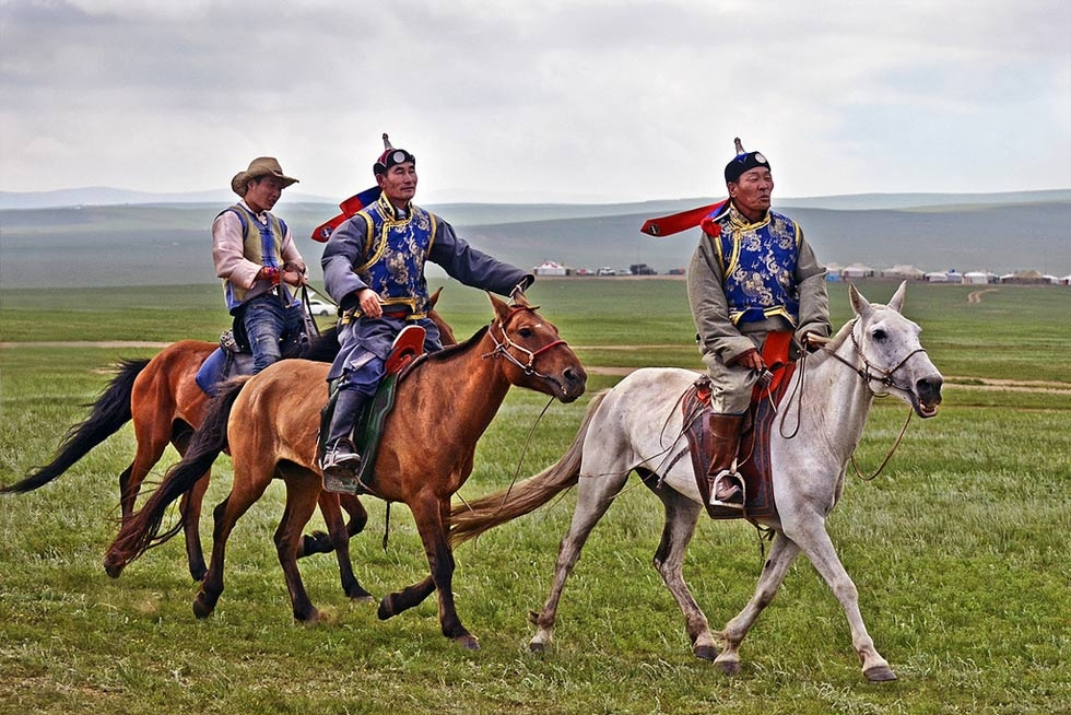 Horse races happen across the Mongolian pastureland during the three-day festival. (scott.presly/Flickr)