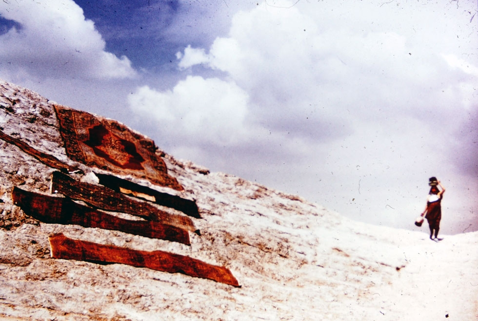 Persian carpets drying on the mountainside after being hand-washed in the special spring waters in the town of Rey.