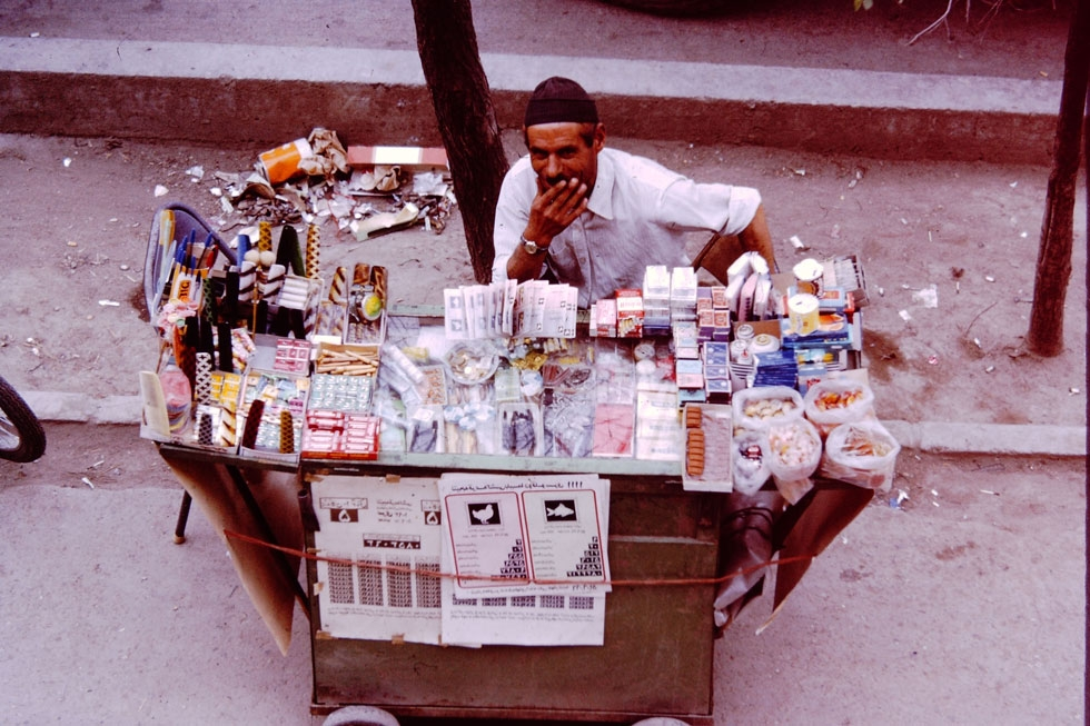 A street vendor sells cigarettes, gum, candy and lottery tickets. Found on many city streets.