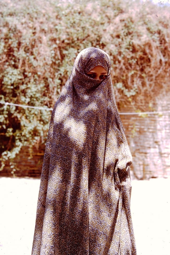 A young Persian girl in her chador.