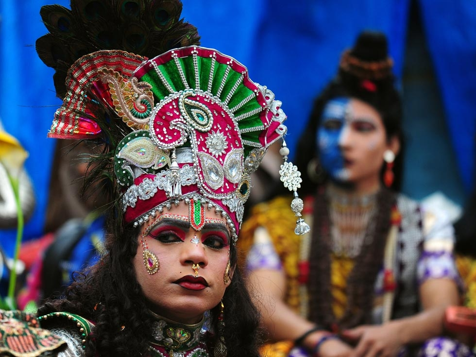A dressed up devotee looks on during a procession for Maha Shivaratri in Allahabad, India on February 27, 2014. (Sanjay Kanojia/AFP/Getty Images)