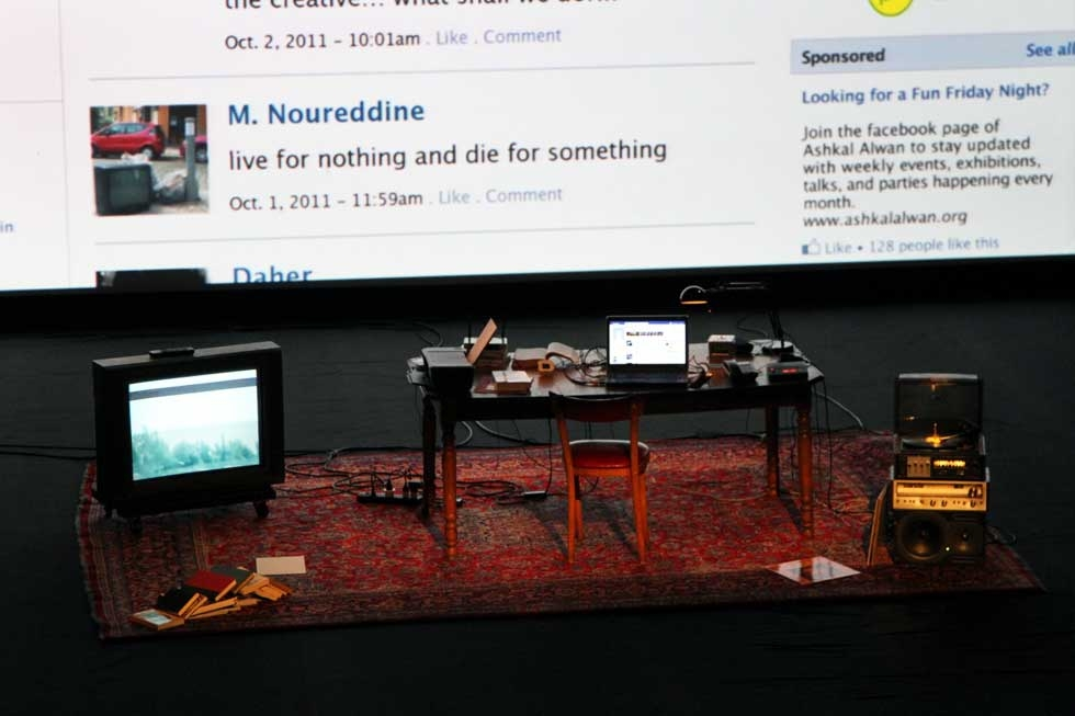 No performers appear onstage during the work: A variety of electronic devices live on in the bedroom of a young Lebanese man who has just killed himself. (Ellen Wallop/Asia Society)