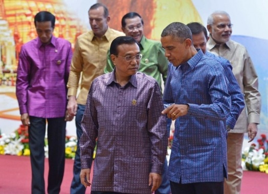 U.S. President Barack Obama walks with China's Premier Li Keqiang after posing for the East Asian Summit family photo at the Myanmar International Convention Center in Naypyidaw on November 12, 2014. (Mandel Ngan/Getty Images)