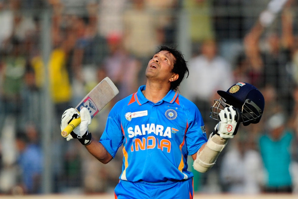 Tendulkar reacts after scoring his hundred century during the one-day international (ODI) Asia Cup cricket match between India and Bangladesh at the Sher-e-Bangla National Cricket Stadium in Dhaka on March 16, 2012. (Munir uz Zaman/AFP/Getty Images)