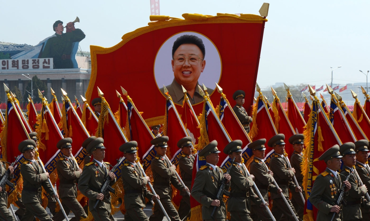 North Korean soldiers carry a portrait of late leader Kim Jong-Il during a military parade to mark 100 years since the birth of the country's founder Kim Il-Sung in Pyongyang on April 15, 2012. (Pedro Ugarte/AFP/Getty Images)