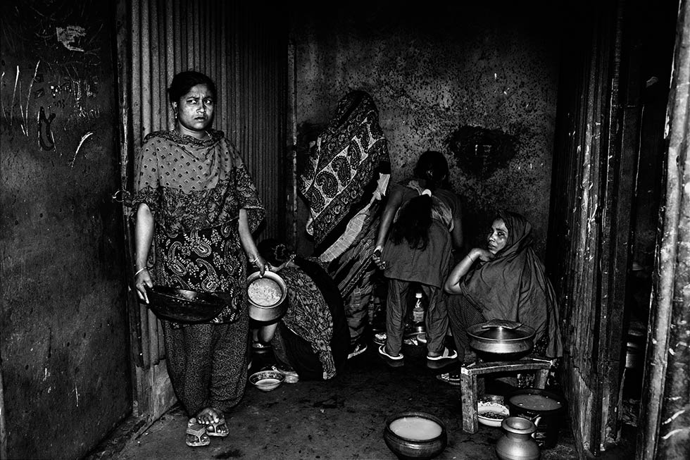 A kitchen with two burners, which 14 families rely on, in Gazipur, Bangladesh. (Gazi Nafis Ahmed)