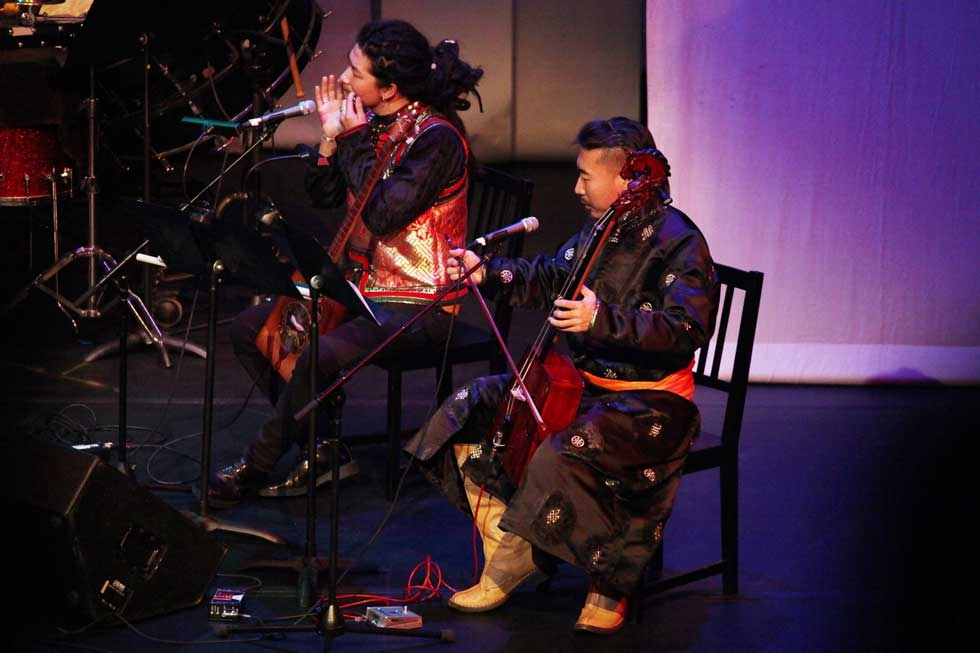 "Musicians Borjigin (on tovshuur, chor, and hoomii) and Khasbagen (morin khurr) in Zulan's three-movement ""Death and the Maiden"" at Asia Society New York on Jan. 13, 2015. (Ellen Wallop/Asia Society)"