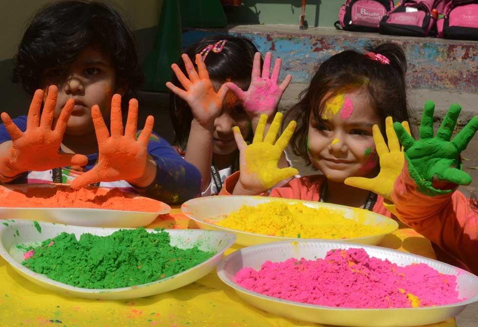 Children pose with color-stained hands during the Holi festival in Siliguri, India on March 4, 2015. (Diptendu Dutta/AFP/Getty Images)