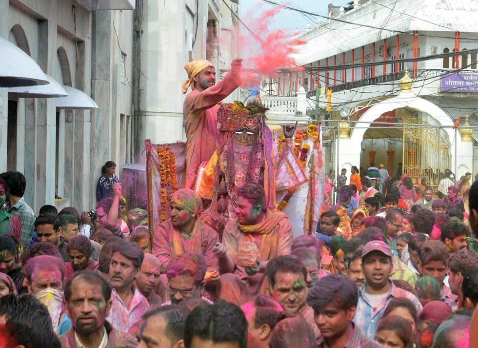 Devotees apply color and participate in a religious procession as they celebrate Holi at the Durgiayana Temple in Amritsar, India on March 5, 2015. (Narinder Nanu/AFP/Getty Images)