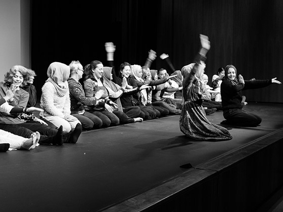 The Tari Aceh troupe teaching workshop attendees the Ratoeh Duek dance. (Vaishali Nayak)