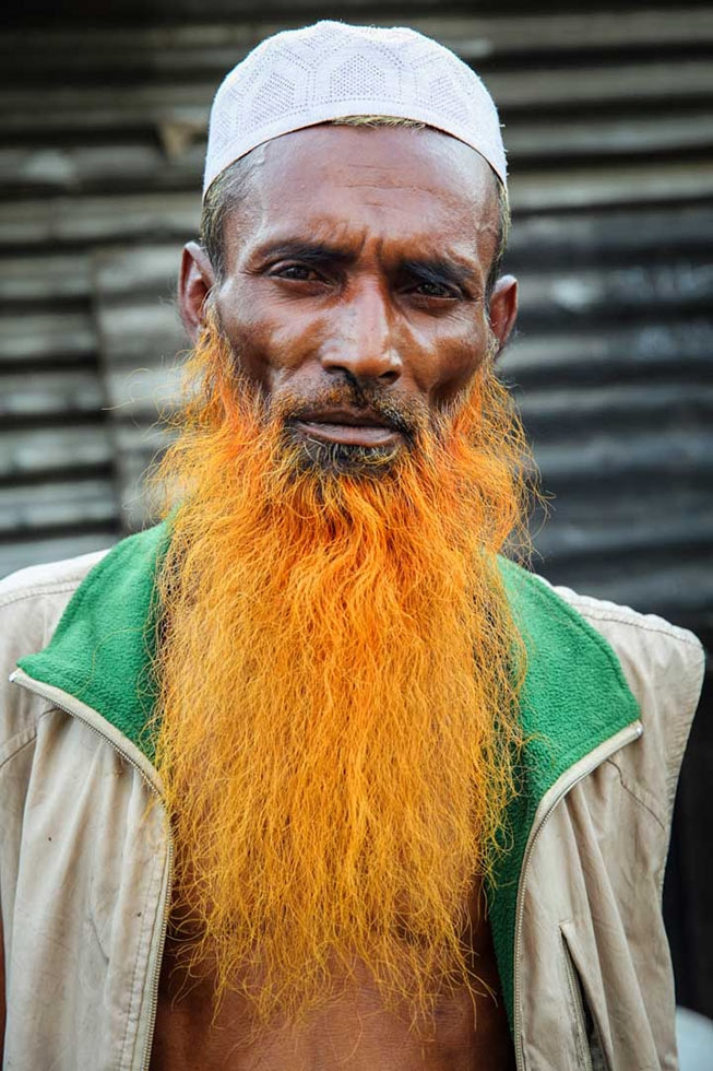 An old man with a light orange henna-dyed beard. (GMB Akash)