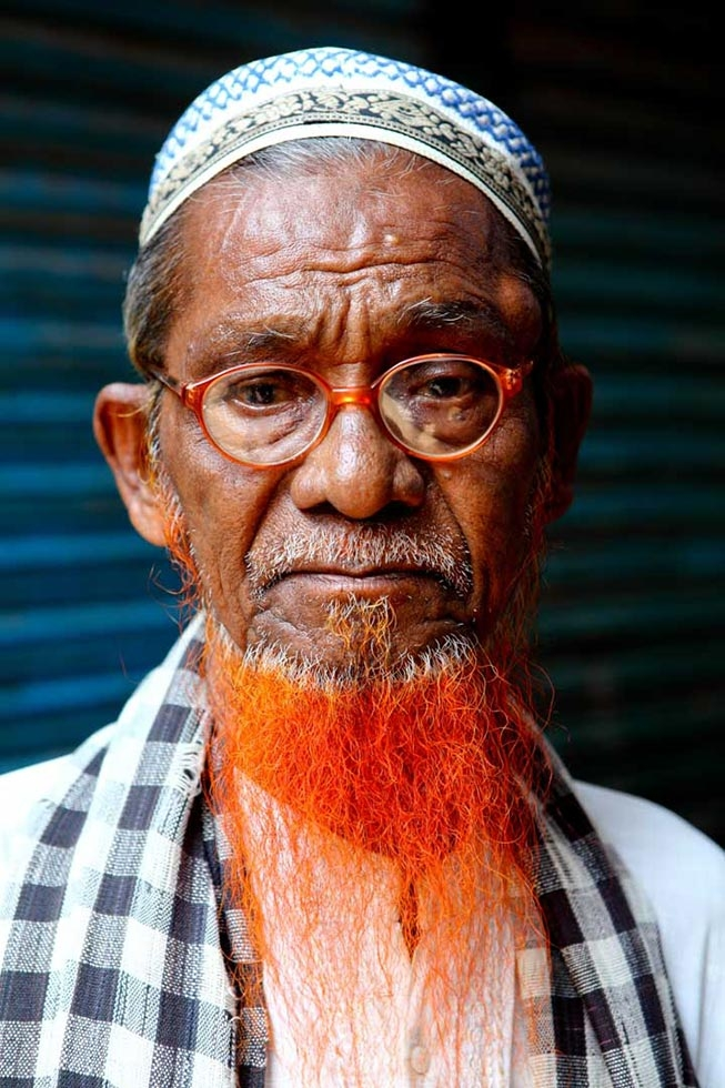 Men with orange facial hair is a common sight in Bangladesh. (GMB Akash)