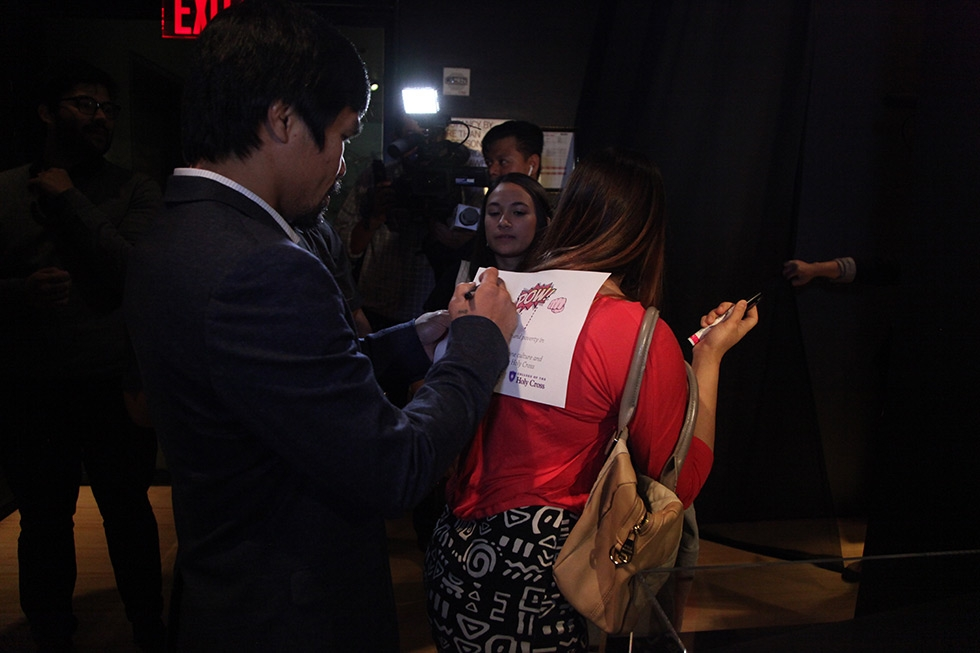 Manny Pacquiao signs an autograph for a fan at Asia Society Museum on Monday, October 12, 2015. (Ellen Wallop/Asia Society)