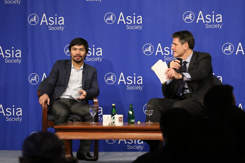 Asia Society Executive Vice President Tom Nagorski poses a question to Manny Pacquiao at Asia Society in New York on Monday, October 12, 2015. (Ellen Wallop/Asia Society)