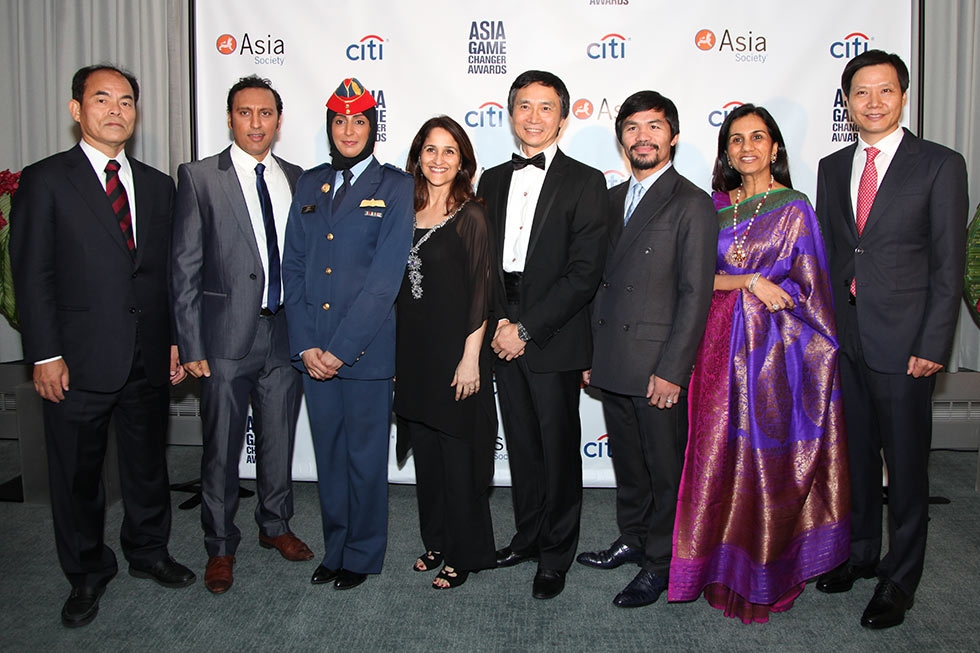 The 2015 Asia Society Asia Game Changers: (L to R): Shuji Nakamura, Aasif Mandvi, Mariam al-Mansouri, Kiran Bir Sethi, Li Cunxin, Manny Pacquiao, Chanda Kochhar, and Lei Jun. Photographed on October 13, 2015. (Ellen Wallop/Asia Society)