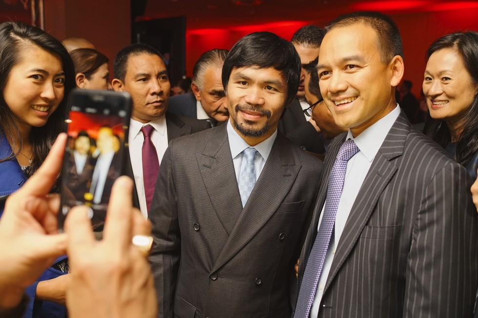 Manny Pacquiao poses with attendees of the 2015 Asia Game Changers award ceremony on October 13, 2015. (Jamie Watts/Asia Society)