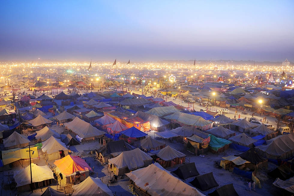 Temporary tents for devotees are pictured at dusk at Sangam, the confluence of the Rivers Ganges, Yamuna, and mythical Saraswati, during the Maha Kumbh Mela in Allahabad on February 13, 2013. (Sanjay Kanojia/AFP/Getty Images)
