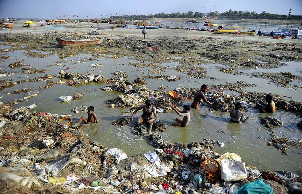 Indian men search for coins and gold in the polluted waters of the Ganga river at Sangam after the Kumbh Mela festival, in Allahabad on April 2, 2013. (Sanjay Kanojia/AFP/Getty Images)