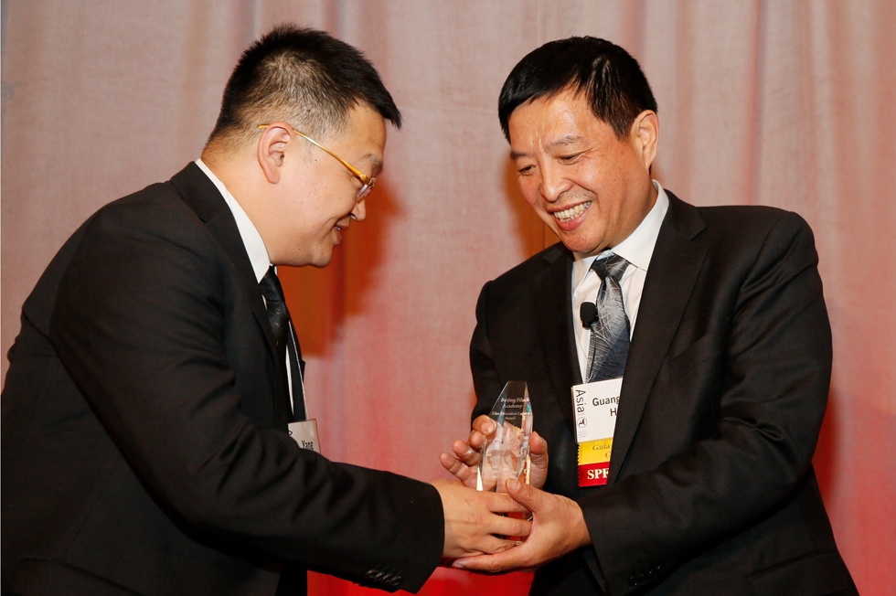 From left, President Gao Yang of Yucheng Zhongluan Investment Group presents Hou Guangmin, Beijing Film Academy, with the Film Education Legacy Award during the 2015 Asia Society U.S.-China Film Summit and Gala held at the Dorthy Chandler Pavilion on Thursday, November 5, 2015, in Los Angeles, Calif. (Ryan Miller/Capture Imaging)