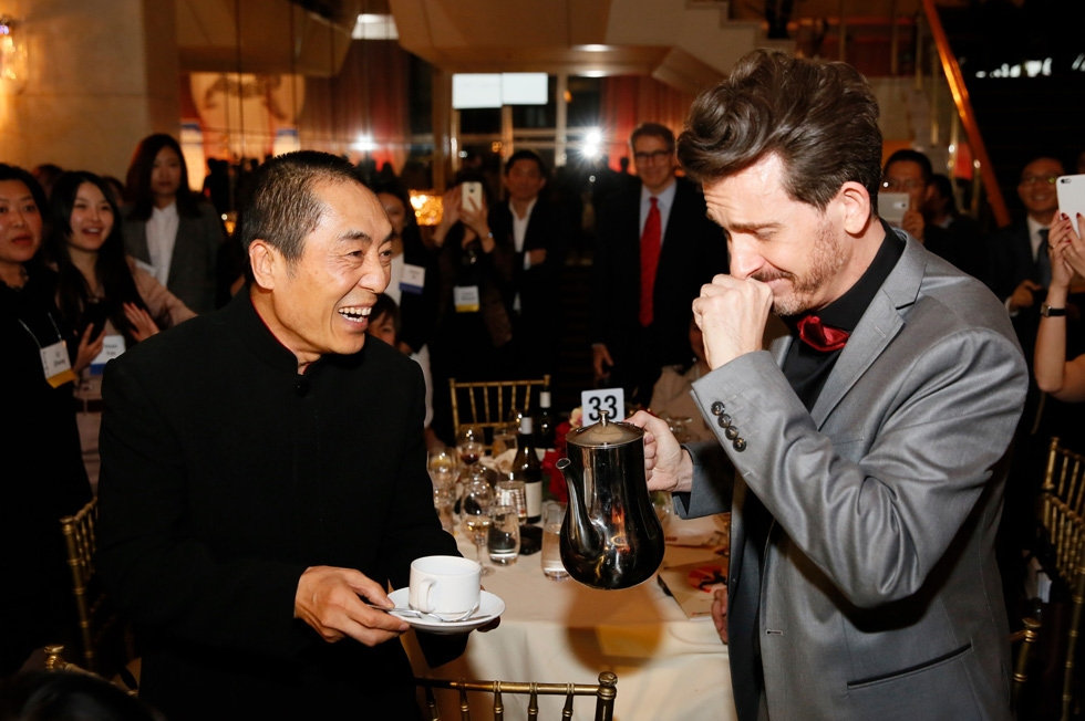 From right, emcee Jeff Locker fulfills a dream to pour Zhang Yimou, director and Lifetime Achievement Award winner, a cup of coffee during the 2015 Asia Society U.S.-China Film Summit and Gala held at the Dorthy Chandler Pavilion on Thursday, November 5, 2015, in Los Angeles, Calif. (Ryan Miller/Capture Imaging)