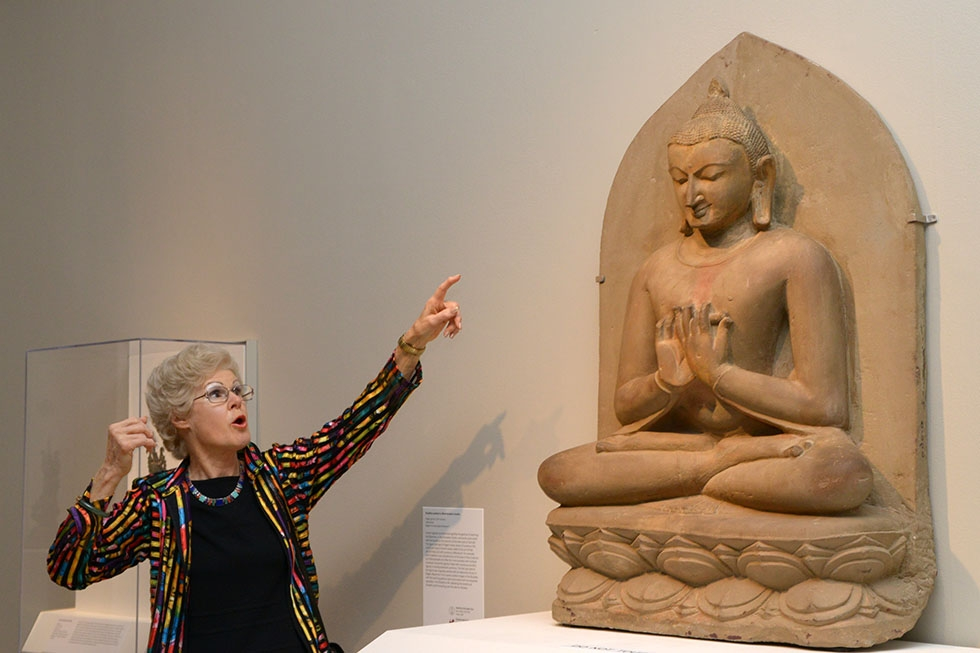 Guest co-curator Sylvia Fraser-Lu shows an artifact on display at the members opening for the Buddhist Art of Myanmar exhibit at Asia Society in New York on February 10, 2015. (Elsa Ruiz/Asia Society)