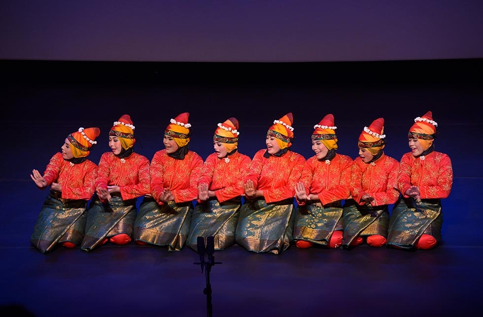 Tari Aceh!, an all-female group from Banda Aceh in Sumatra, Indonesia, performs the traditional Acehnese dance at Asia Society in New York on February 28, 2015. One of the hallmarks of this dance is a form of body percussion in which various rhythms are created by slapping the body or clapping. (Elsa Ruiz/Asia Society)