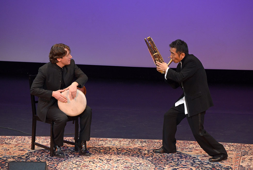 Wu Tong, a founding member of the Silk Road Project ensemble, dazzles an Asia Society crowd in New York on March 19, 2015 with his virtuosity on the sheng, a traditional Chinese wind instrument. He is joined onstage by Shane Shanahanon on vibraphone and percussion. (Elsa Ruiz/ Asia Society)