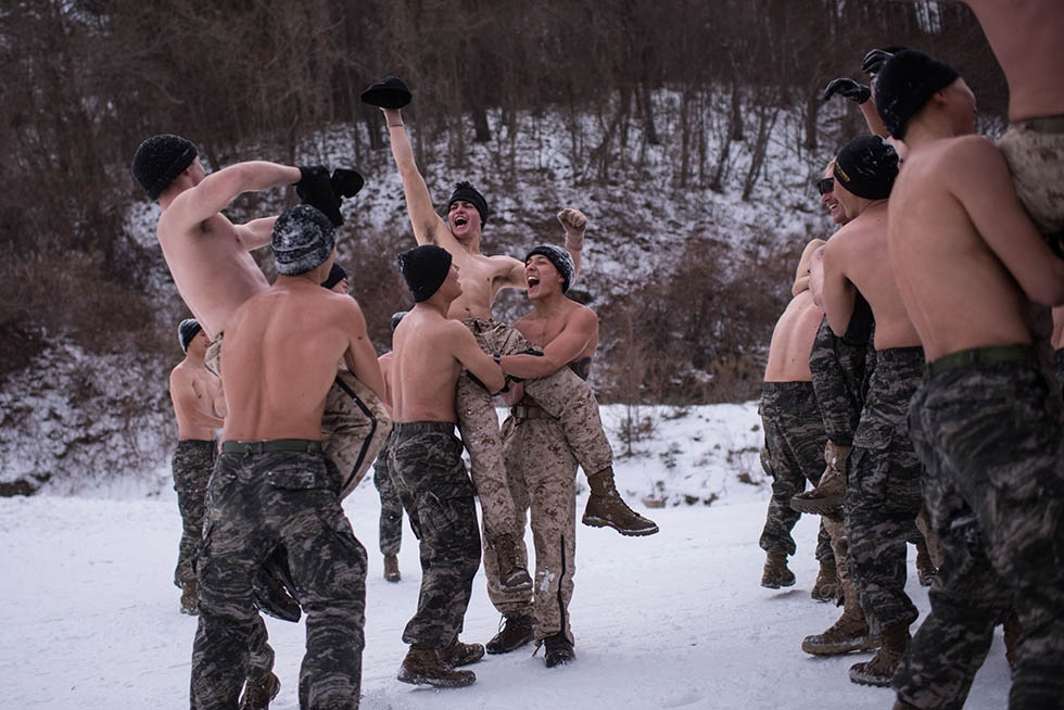 South Korean and U.S. soldiers wrestle during a joint annual winter exercise in Pyeongchang, South Korea on January 28, 2016. (Ed Jones/AFP/Getty)