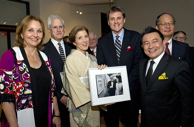 "Ambassador Caroline Kennedy holds a photo of her mother, Jacqueline Kennedy, when she visited Asia Society in 1965 at the opening of the exhibition ""Gods, Thrones, and Peacocks: Northern Indian Painting From Two Traditions."" (Elena Olivo/Asia Society)"