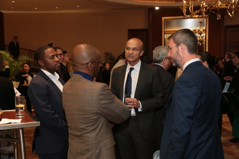 From left to right: guest; Strive Masiyiwa, Asia Society Trustee; Omar Ishrak, Asia Society Trustee; and guest.
