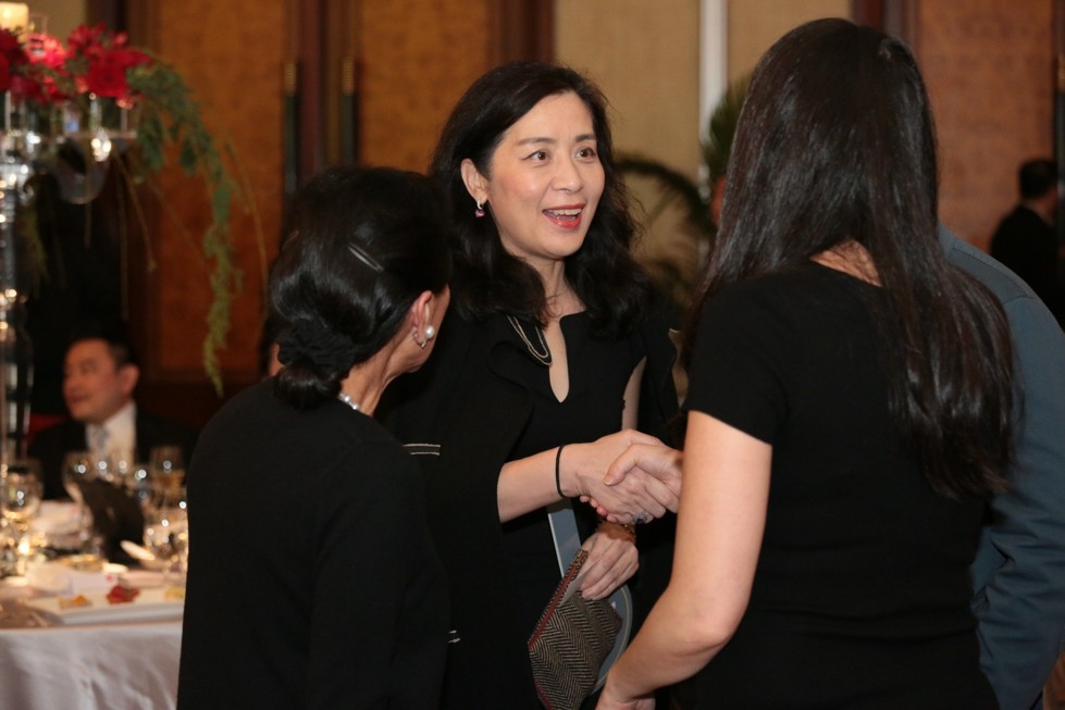 Lulu C. Wang, Vice Chair of the Board, Asia Society (left), introduces Jinqing Caroline Cai, President of Christie's China, to a guest.
