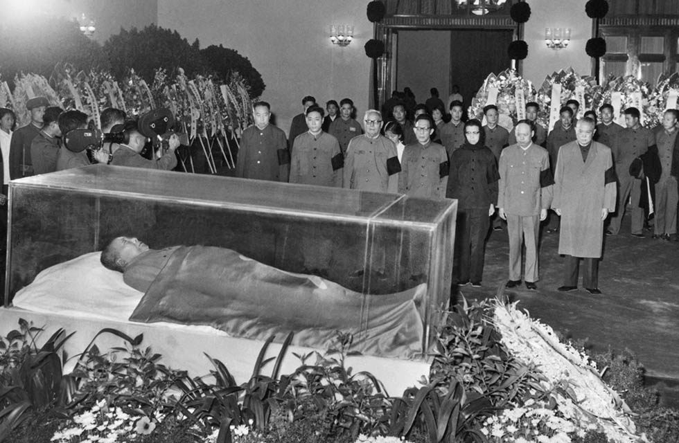 On September 9, 1976, Mao Zedong died at age 82 after ruling China for 27 years. His death effectively ended the Cultural Revolution. In this photo from September 13, 1976, party and state leaders pay their respects to Mao's remains. (Xinhua/AFP/Getty Images)
