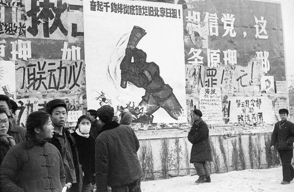 "A group of Chinese youth walk past several ""dazibaos"" (revolutionary placards) in February 1967 in downtown Beijing. (Jean Vincent/AFP/Getty Images)"