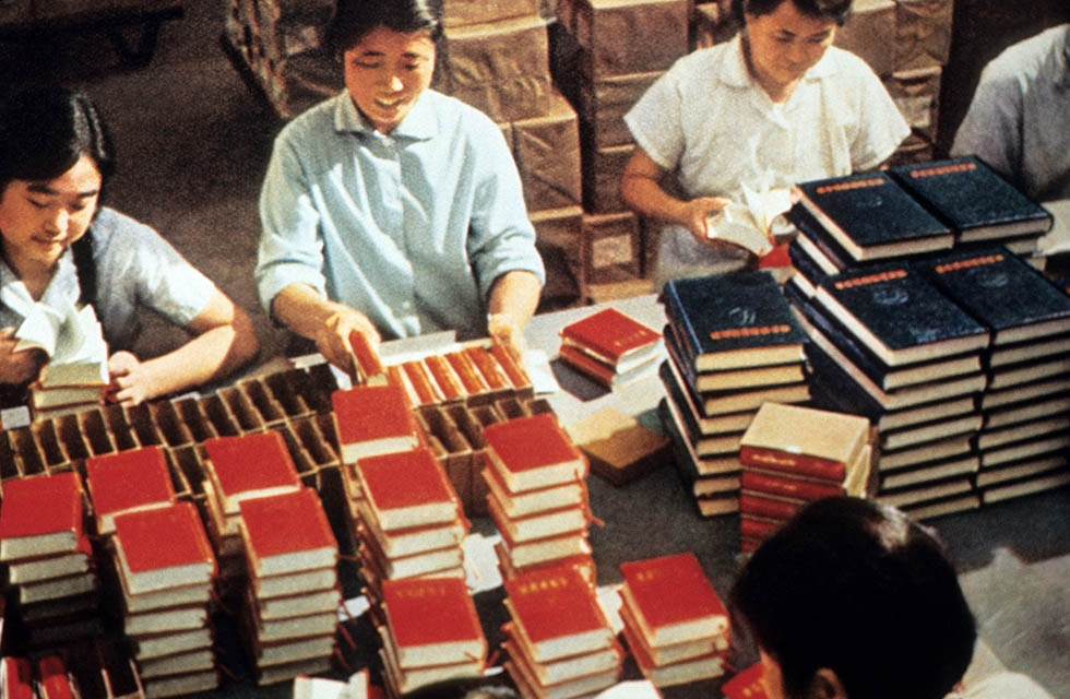 "Employees of the Government Printing House in Beijing pack copies of Mao Zedong's ""Little Red Book"" in 1971. The book teaches the philosophy of Mao based on Marxism-Leninism adapted to Chinese conditions. Maoism shifted the focus of revolutionary struggle from the urban workers, or proletariat, to the countryside and the peasantry. (STR/AFP/Getty Images)"