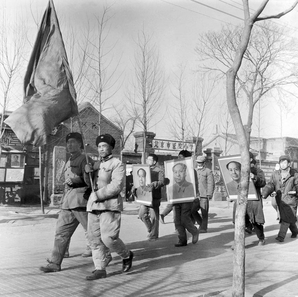 A group of Chinese Red Guards shout slogans while parading with portraits of Mao Zedong on January 21, 1967 in downtown Beijing. Their aim was to arouse townspeople and villagers to recapture the victorious 1949 revolutionary zeal, and ferret out those who have departed from Mao's ideals. (Jean Vincent/AFP/Getty Images)