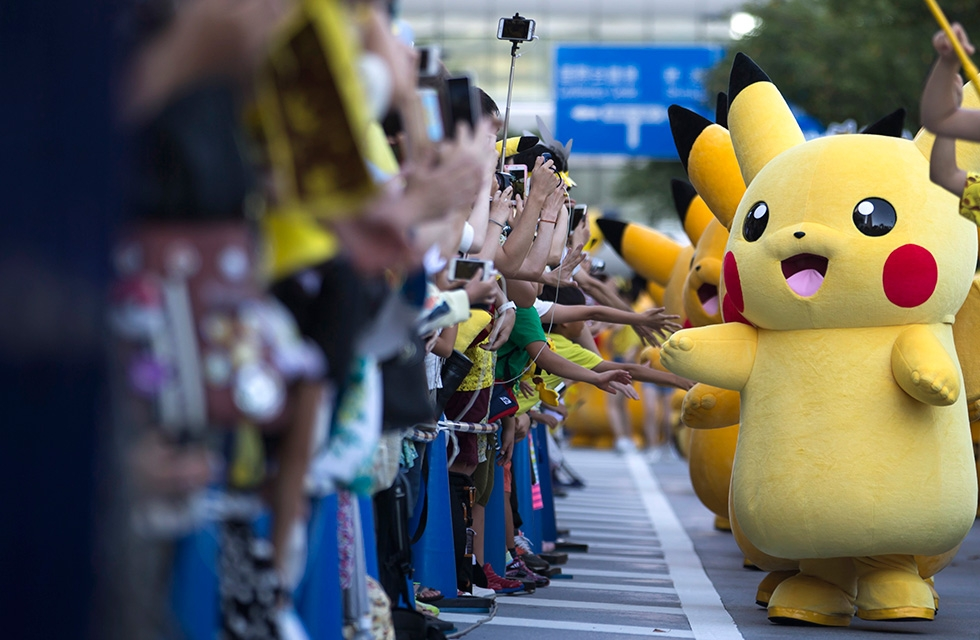 Performers dressed as Pikachu, a character from Pokémon, march during the Pikachu Outbreak event hosted by The Pokémon Co. on August 7, 2016 in Yokohama, Japan. (Tomohiro Ohsumi/Getty Images)