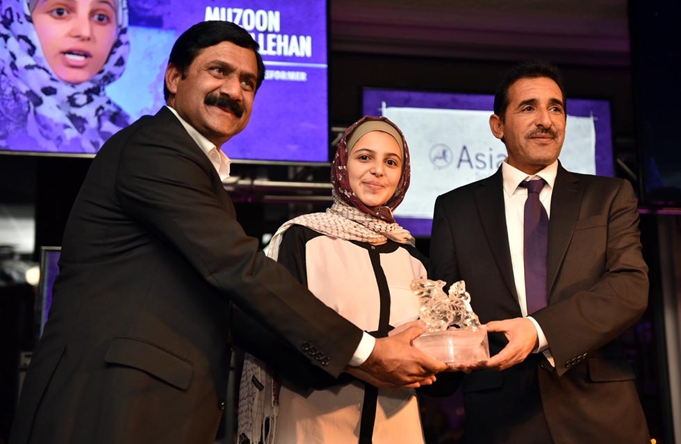 Ziauddin Yousafzai (L), Muzoon Almellehan (C), and Muzoon's father (R) show off her Asia Game Changer Award on October 27, 2016. (Jamie Watts/Asia Society)