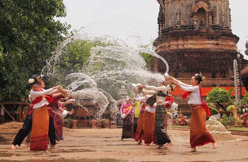 Celebrants are pictured at a temple in Chiangmai, Thailand splashing water on each other for celebration on May 2, 2010. (Hwannaa/Getty Images)
