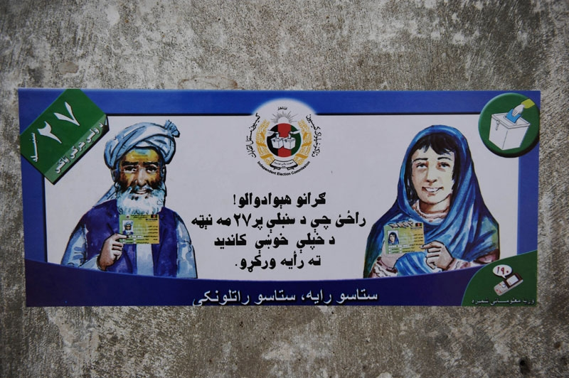 A poster urging Afghans to vote in upcoming elections is stuck to a wall in Kandahar province's Arghandab Valley on August 11, 2010. (Yuri Cortez/AFP/Getty Images)