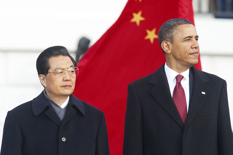 US President Barack Obama stands with Chinese President Hu Jintao (L) during a State Arrival ceremony on the South Lawn of the White House in Washington, DC, on Jan. 19, 2011. (Paul J. Richards/AFP/Getty Images)